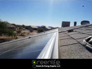 Residential Solar Panels Installed On Flat Roof Near Phoenix
