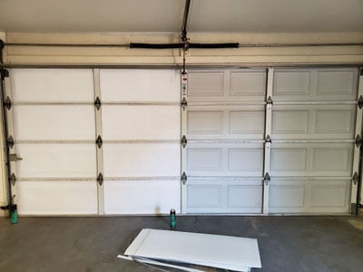 Install garage door insulation